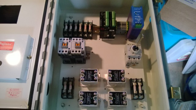 The 'guts', prewiring days. How much more accessible is that than my old panel?