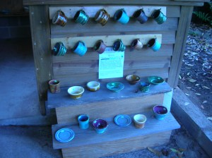 A selection of pots from the kids section that are all half off the adult price to young customers.