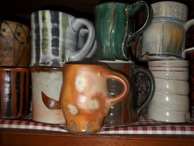 Tom White's mug collection, including pots by Gay Smith, Michael Hunt, Linda Christianson, Bruce Gholson, Sam Taylor, Barbara Knutson and Allison Severance