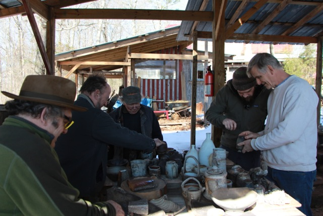 Jonathan Carter captures a picture of Tony Clennell, me, Ron Meyers, Kyle Jones, and Steve Driver gawking at fresh pots from Ron's wood kiln.