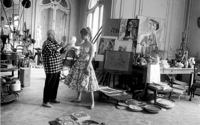 Bridget Bardot resisting the urge to be knolled into Pablo Picasso's studio