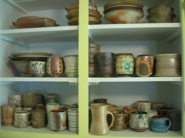 Look at all those lovely cups, mugs, and bowls! Its true that I made a few of them, but my kitchen and my life are filled with my support for the work of other potters. Their brilliance lights the way for my own creative efforts.